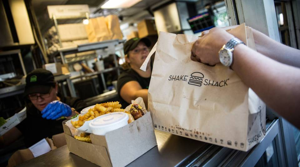 Customers pick up their orders from Shake Shack in Madison Square Park in New York City.