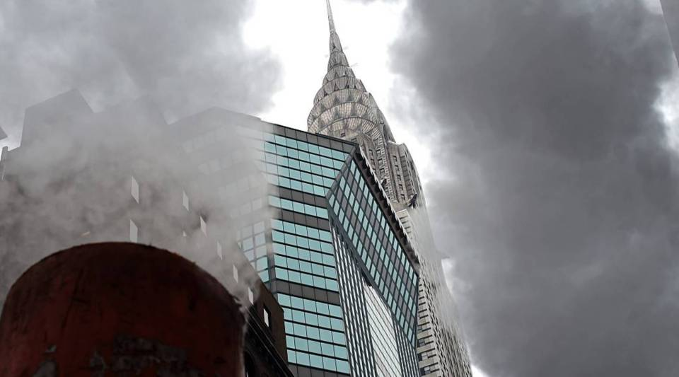 The Chrysler Building in the background as steam rises from a steam pipe on Lexington Avenue in New York March 4, 2015 as warming temperatures start to melt snow.