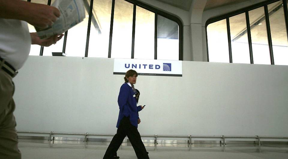 An employee walks through the United Airlines terminal at Newark Liberty Airport on July 8, 2015 in Newark, New Jersey.