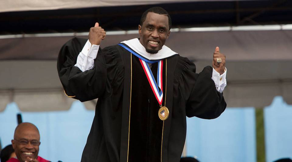 Entrepreneur and philanthropist Sean 'Diddy' Combs reacts after delivering the commencement speech at Howard University's 146th commencement exercises on May 10, 2014 in Washington, D.C.