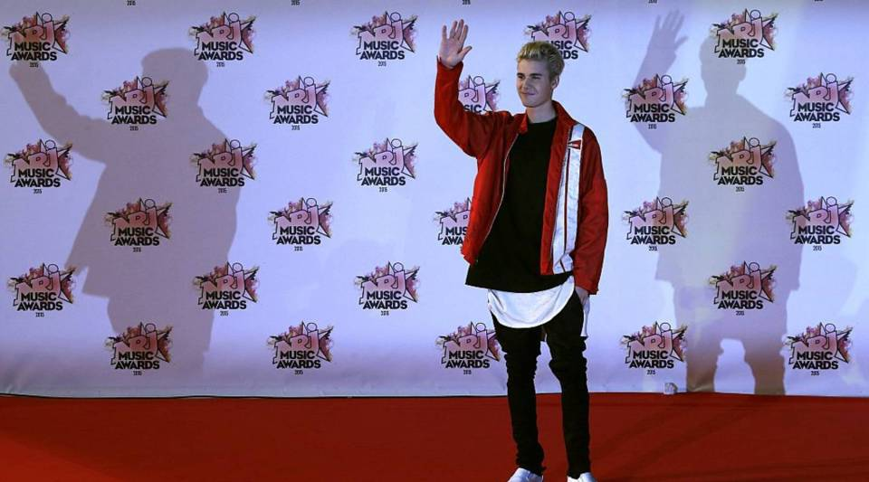 Canadian singer Justin Bieber poses on the red carpet upon his arrival at the Palais des Festivals to attend the 17th Annual NRJ Music Awards in Cannes, southeastern France, on November 7, 2015.