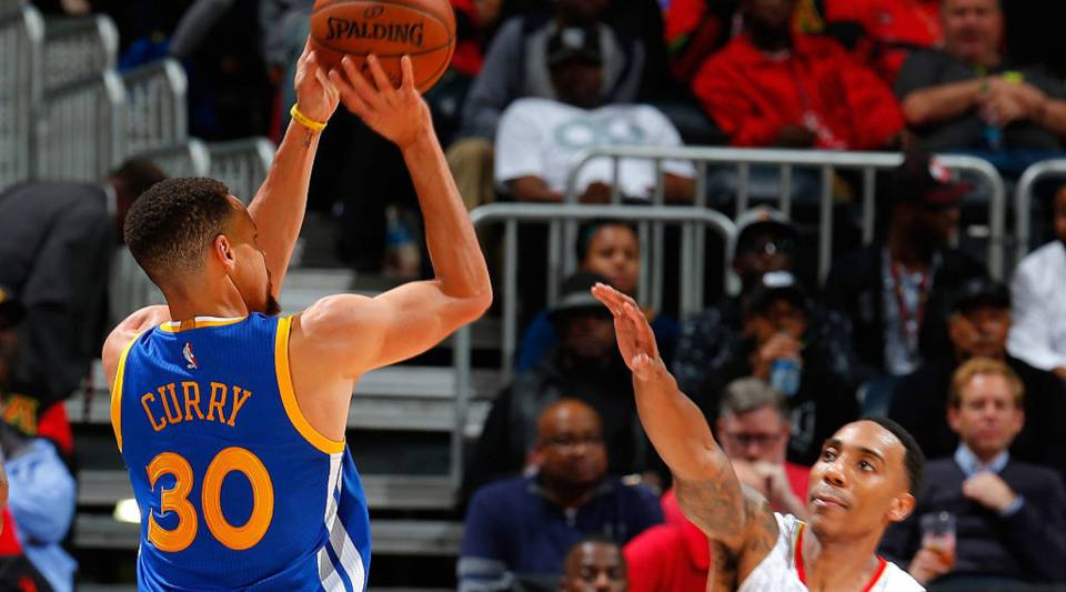 Stephen Curry #30 of the Golden State Warriors shoots a three-point basket against Jeff Teague #0 of the Atlanta Hawks at Philips Arena on February 22, 2016 in Atlanta, Georgia.
