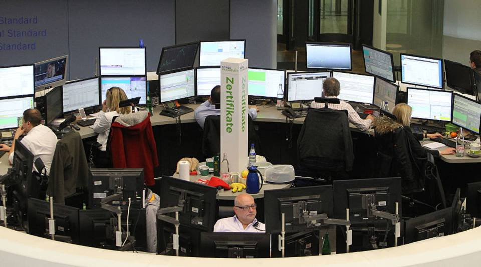 This picture shows brokers at the stock exchange in Frankfurt, Germany, on February 26, 2016. Frankfurt stock exchange operator Deutsche Boerse revealed Friday that in the proposed tie-up with the London Stock Exchange the merged group would be based in the British capital.