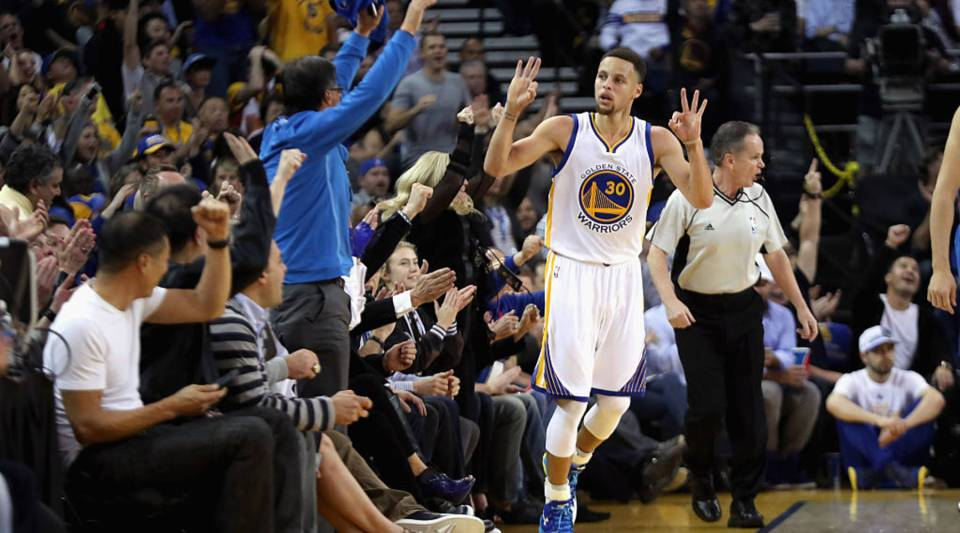 Stephen Curry of the Golden State Warriors reacts after making a three-point basket against the Oklahoma City Thunder at ORACLE Arena on March 3, 2016 in Oakland, California.
