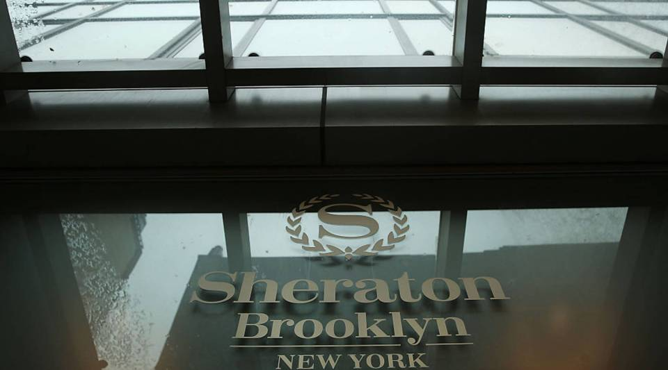 A Sheraton Hotel sign stands in downtown Brooklyn on March 14, 2016 in New York City. A fight for the Starwood Hotel chain, which Sheraton is a member of, is underway following a $14 billion buyout offer Monday from a consortium led by China's Anbang Insurance Group.