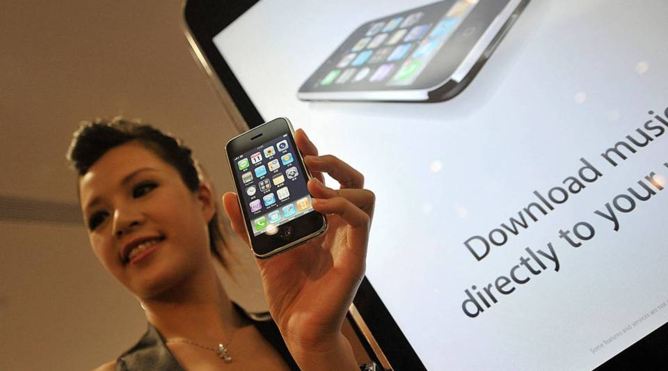 A model shows a 3G iPhone during its launch sale in Hong Kong on July 11, 2008. The iPhone 3G was the first model with access to Apple's App Store.