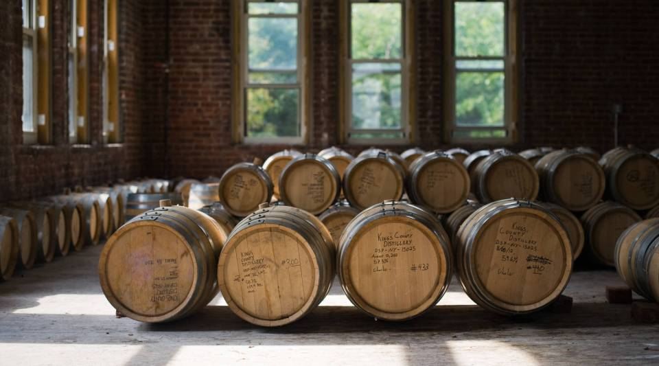 """Barrels of whiskey aging at the Kings County distillery. Colin Spoelman, Kings County's master distiller says when it comes to aging whiskey, a barrel can be like a tea bas. """"The first time you use it, you get a lot of spice, a lot of infusion, flavor."""""""