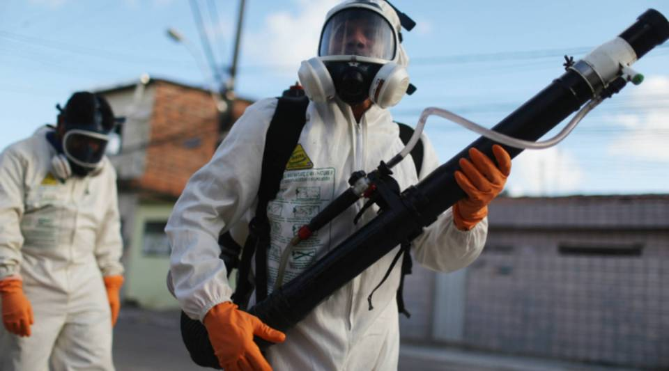 Health workers in Brazil fumigate in an attempt to eradicate the mosquito which transmits the Zika virus. In the U.S.,the Centers for Disease Control and Prevention are trying to organize efforts to combat the virus.