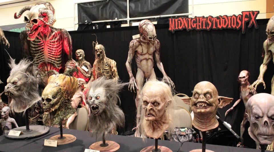 A display of masks at Monsterpalooza 2013.