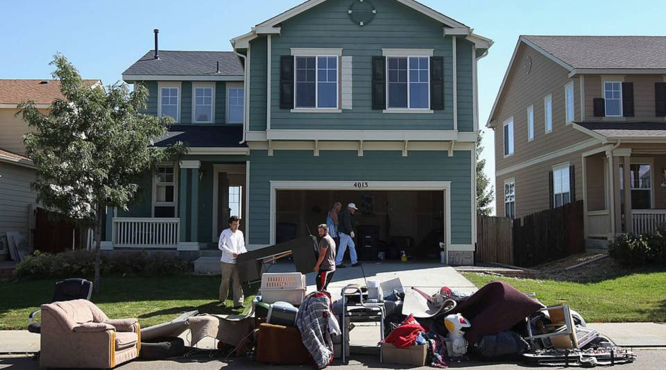 An eviction team removes furniture during a home foreclosure on September 21, 2011 in Longmont, Colorado.