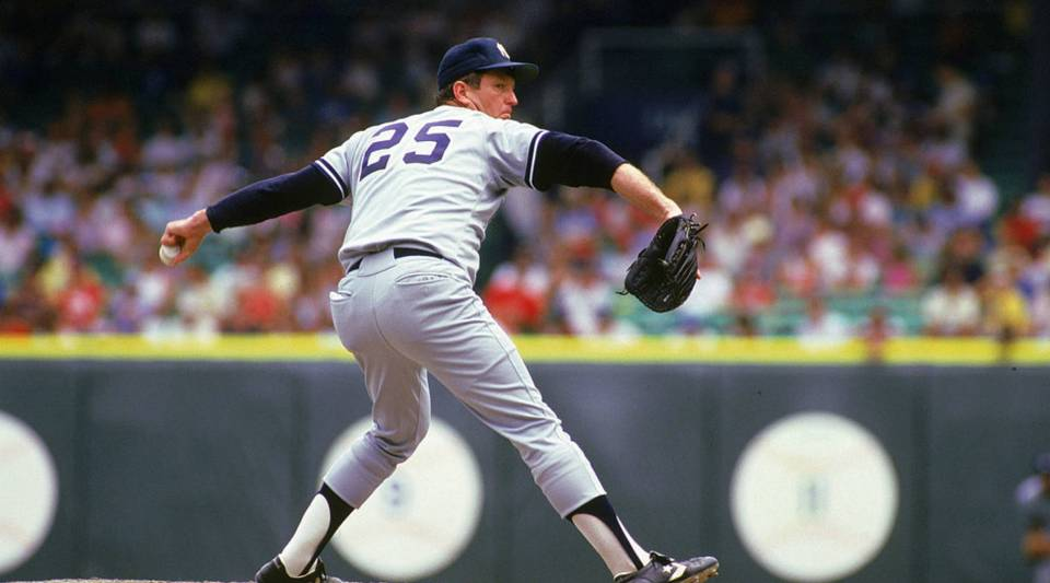 Tommy John #25 of the New York Yankees pitches during a 1987 season game against the White Sox at Comiskey Park in Chicago Illinois.