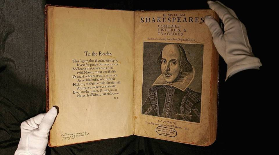 A Sotheby's employee handles a copy of William Shakespeare, The First Folio 1623 on July 7, 2006 in London, England.