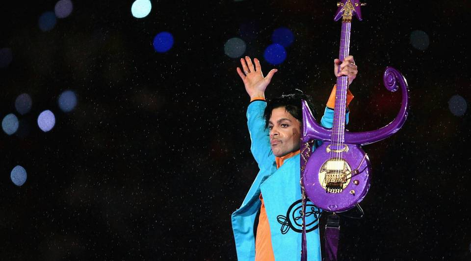 Prince performs during the halftime show at Super Bowl XLI on February 4, 2007 at Dolphin Stadium in Miami Gardens, Florida.