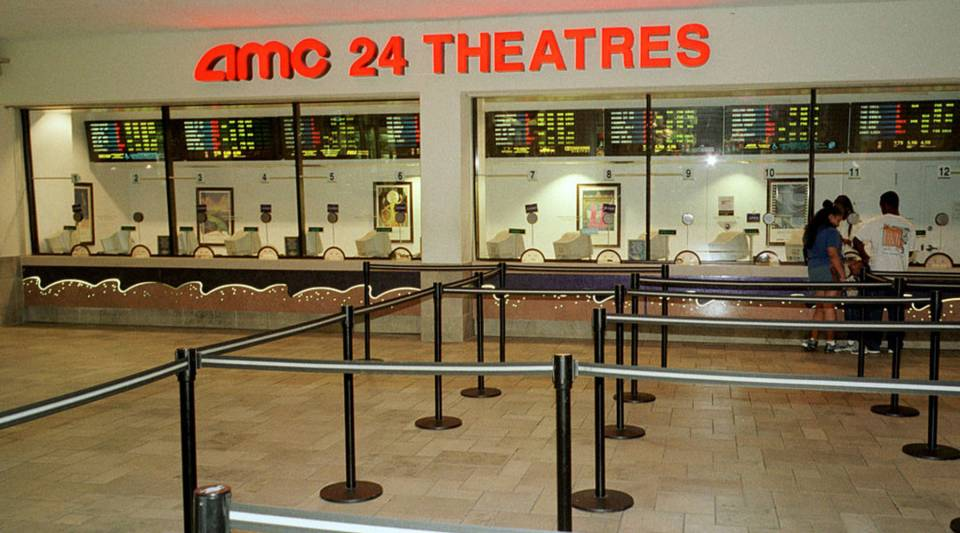 A family buys tickets for a movie showing at the empty American Movie Center complex September 6, 2000 in Miami, Florida.