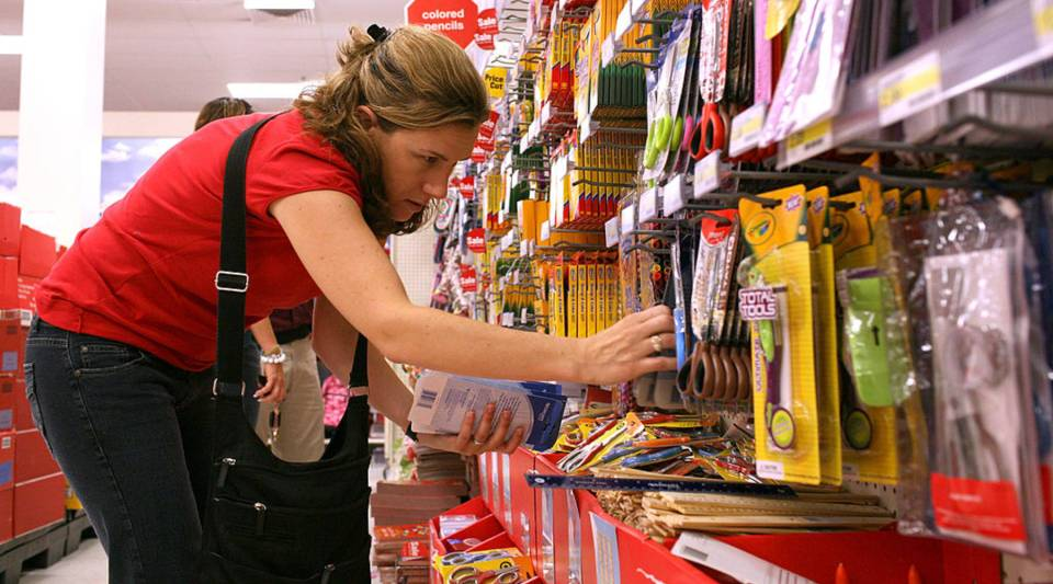 A woman shops at Target for school supplies.