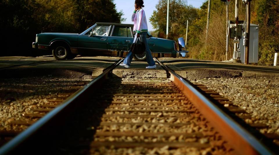 A pedestrian crosses train tracks in Birmingham, Alabama.