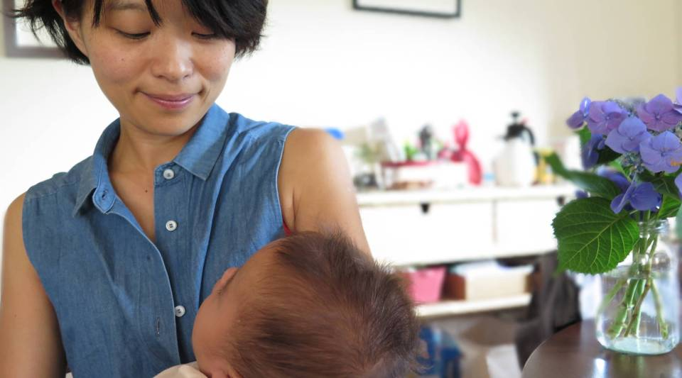 """Kumi Matsumoto and her second child in Tokyo. On balancing the demands of motherhood and work in Japan, """"I'm the kind of woman who does not think that quitting is realistic choice,"""" she said."""