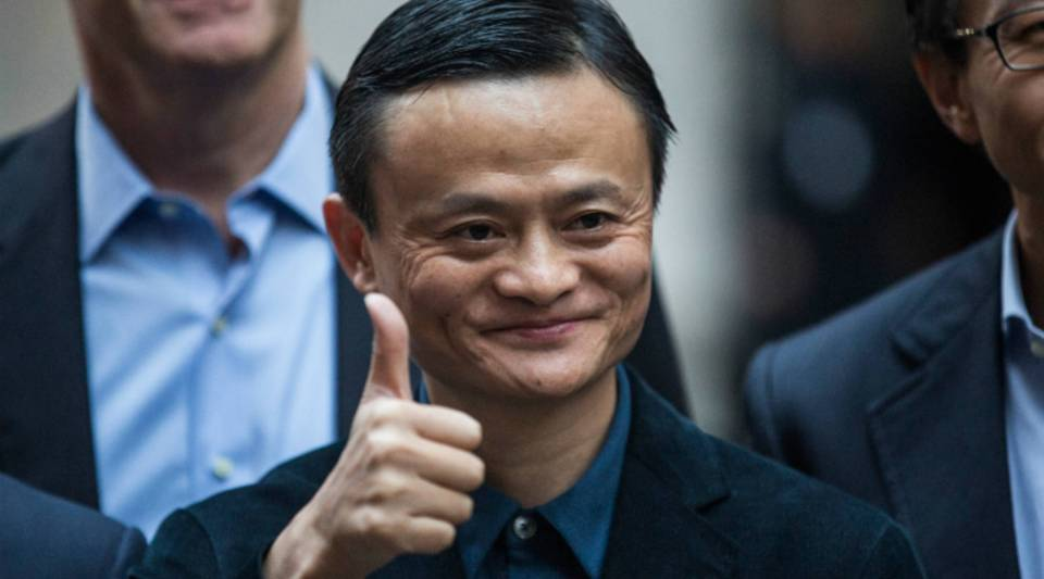 Executive Chairman of Alibaba Group Jack Ma poses for a photo outside the New York Stock Exchange.