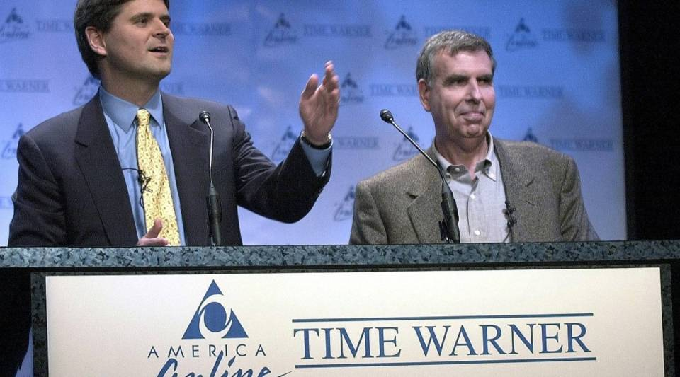 Steve Case, left, then chairman of AOL, and Gerald Levin, then chairman of Time Warner. announce the merger of their companies on Jan. 10, 2000.