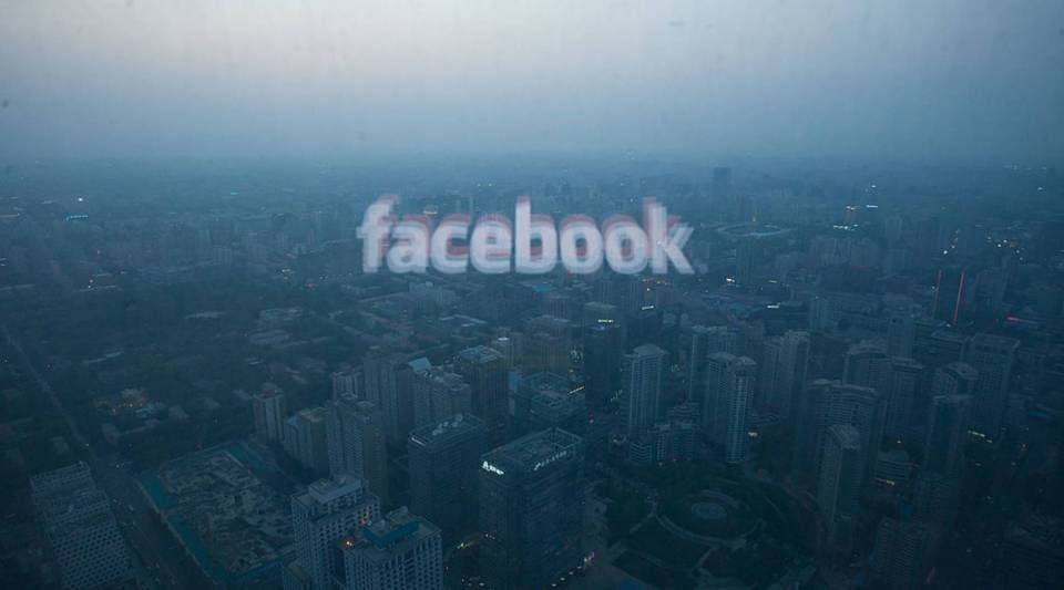 A computer screen displaying the logo of social networking site Facebook is reflected in a window before the Beijing skyline. China'sgovernmentis one of the toughestwhen itcomes to censoring social media.