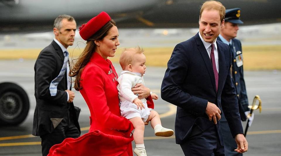 Britain's Prince William and his wife Catherine, carrying baby Prince George, arrive at the international airport in Wellington on April 7, 2014.