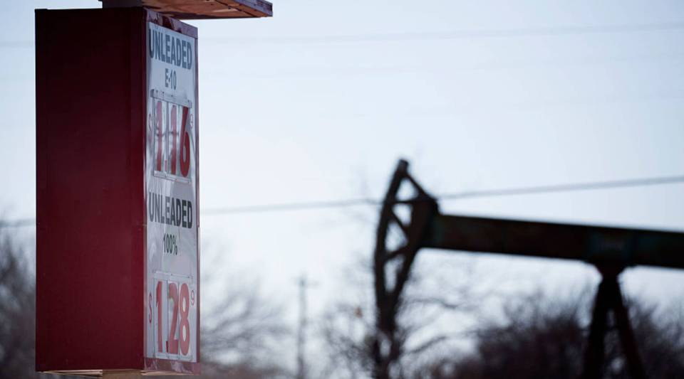 A gas station, near an oil well pumper, was selling gas for $1.16 a gallon February 12, 2016 in Oklahoma City, Oklahoma.