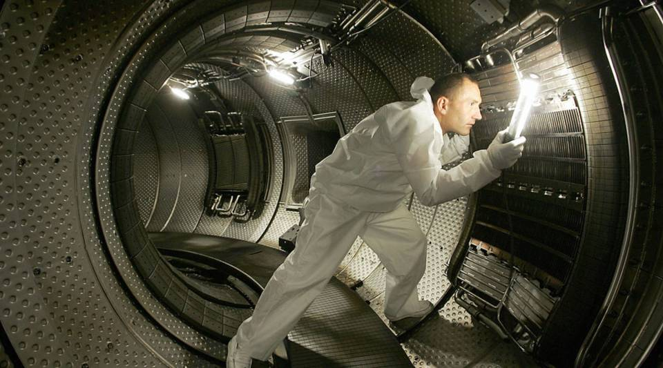 This photo taken 28 July 2004 in Cadarache shows a technician checking a plasma heating system inside a chamber of the Tore Supra nuclear reactor.