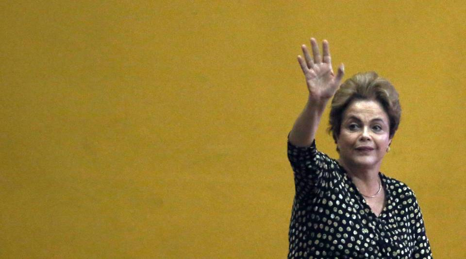 Embattled Brazilian President Dilma Rousseff waves as she enters to speak at a women's rights conference on May 10, 2016 in Brasilia, Brazil.