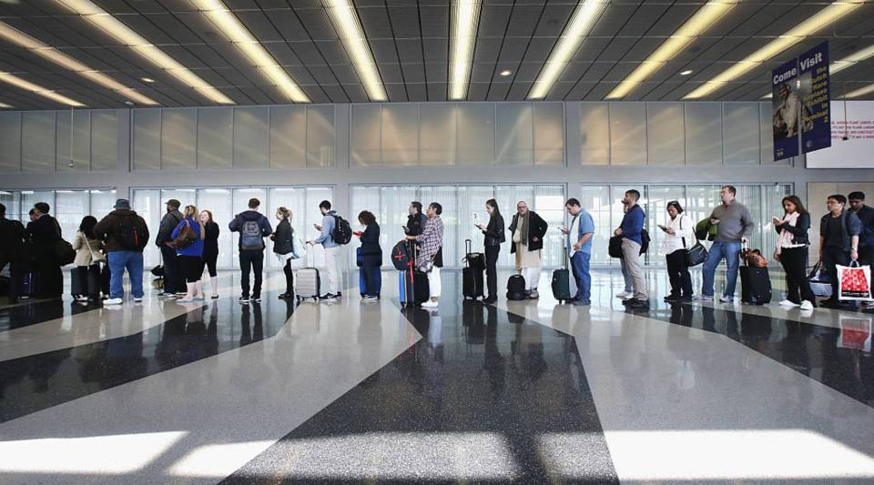 Passengers at O'Hare International Airport wait in line to be screened at a Transportation Security Administration (TSA) checkpoint on May 16 in Chicago, Illinois. The long lines have been blamed for flight delays and a large number of passengers missing flights completely.