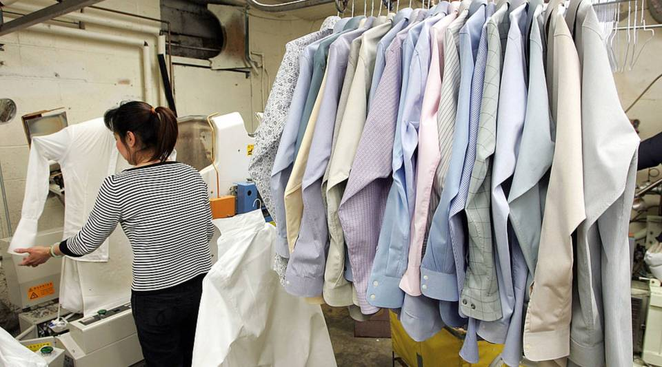 A worker at Sohn's French Cleaners, which uses eco-friendly chemicals to dry clean clothes, presses shirts in 2007 in San Francisco.  A proposed law would give the Environmental Protection Agency the authority to evaluate whether certain chemicals should remain on the market. These chemicals include Trichloroethylene, which is typically used in dry cleaning, protective coating and industrial greasers.