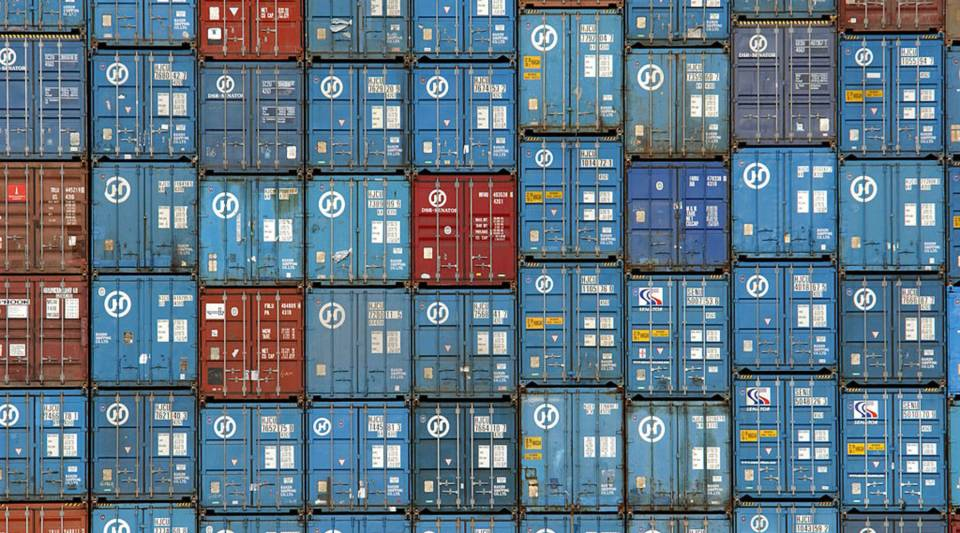 Thousands of truck-sized 30-ton shipping containers are stacked aboard the Hanjin Oslo freighter in the Port of Los Angeles in 2002.