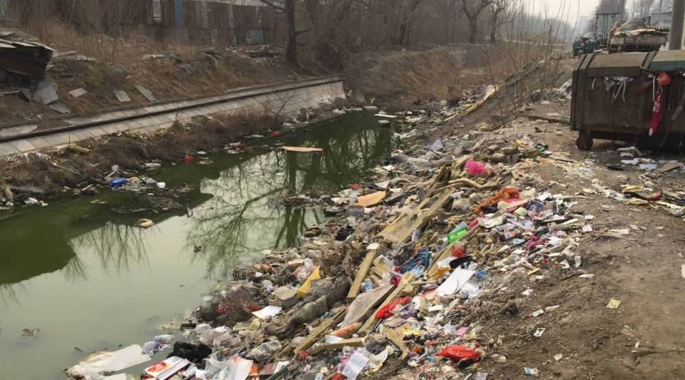 The Xiaolong River in a southern suburb of Beijing is filled with trash. Citizens throughout China are being asked to report such rivers to the authorities in a new government campaign aimed at cleaning up its polluted waterways.