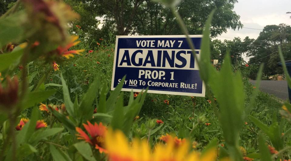 """""""For""""' and """"Against"""" Proposition 1 signs adorn Austin lawns. The issue will be decided on May 7."""