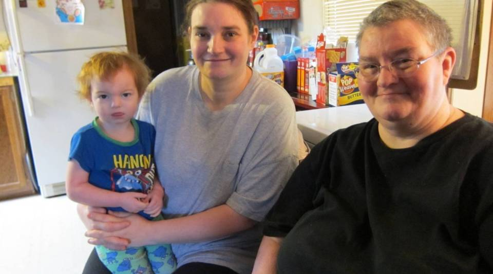 Josephine Moore (right) at home in Kermit, West Virginia, with her daughter, Carolina, and grandson, Latham.