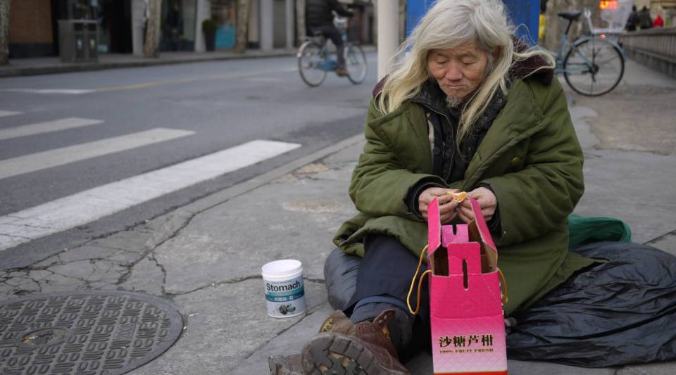 62 year-old Zhang Naisun spends his evenings begging for money on the Street of Eternal Happiness. It's been twelve years since Zhang last spent a lunar New Year holiday with his family in rural Henan province.