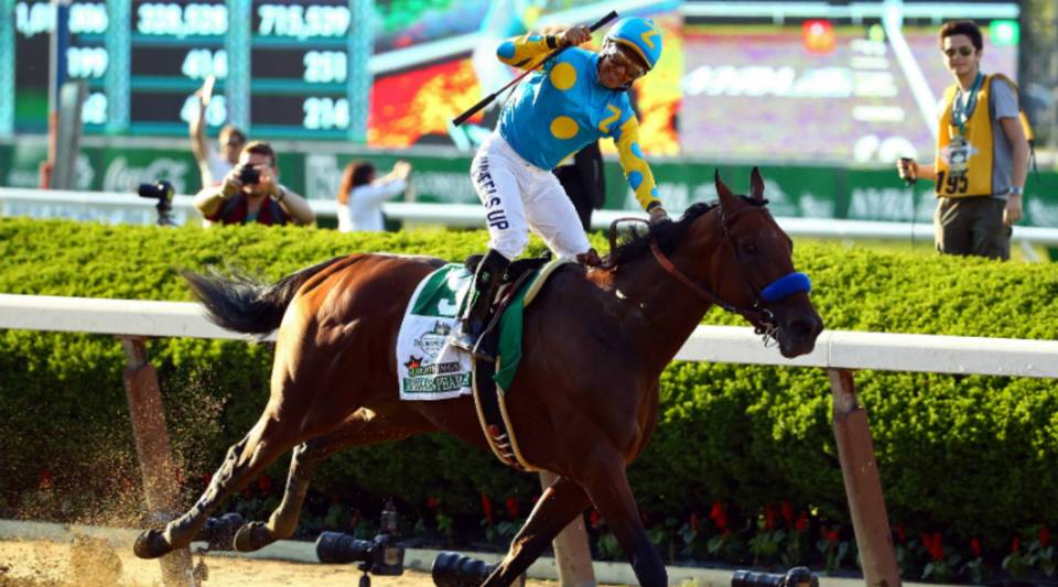 Victor Espinoza celebrates atop American Pharoah after winning the 147th running of the Belmont Stakes on June 6, 2015, in Elmont, New York.