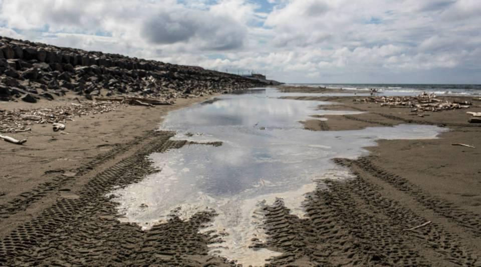 The tide comes in on a beach along the Chukchi Sea in Shishmaref, Alaska.
