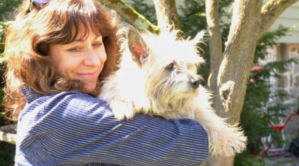 Suki, a 15-year old Cairn terrier, enjoys a little sunshine and a patch of green. Her owners are choosing pet hospice and palliative care as her health declines.