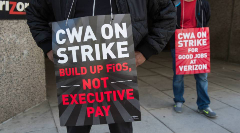Striking Verizon workers picket in front of a Verizon office in Washington, D.C., on April 14.