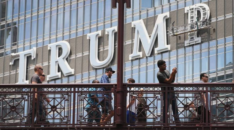 """""""Glitz and ego"""" is how Blair Kamin, architecture critic at the Chicago Tribune, summed up Trump's architecture. Above, workers install the final letter for a giant sign on  Trump Tower  in Chicago."""