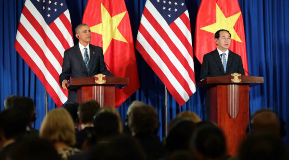 """Vietnam's President Tran Dai Quang and U.S. President Barack Obama take part in a joint press conference at the International Convention Center in Hanoi on Monday. Obama praised """"strengthening ties"""" between the U.S. and Vietnam at the start of his landmark visit."""