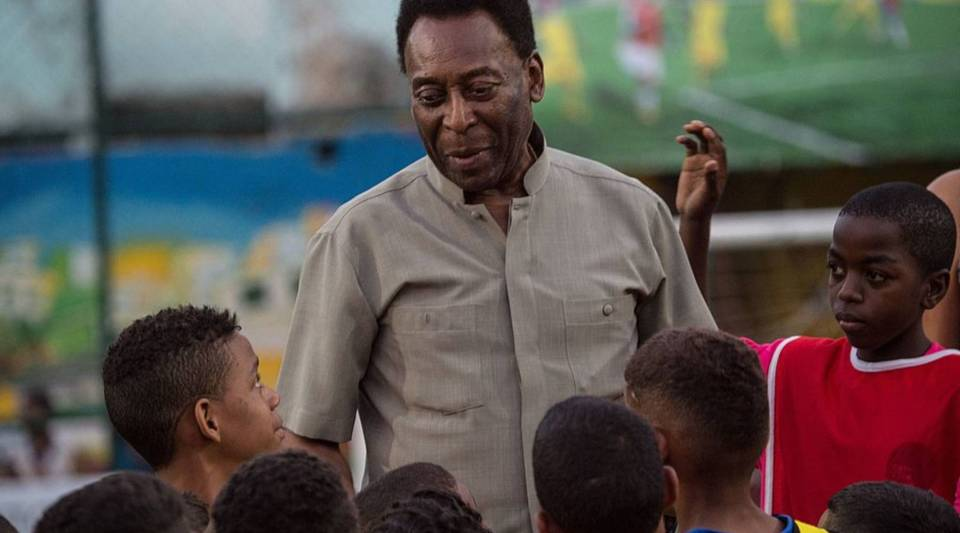 Former soccer player Pele speaks with children in Rio de Janeiro, Brazil, in 2014. The athlete's auction of memorabilia begins today and a portion of the proceeds will go to a children's hospital in Brazil.