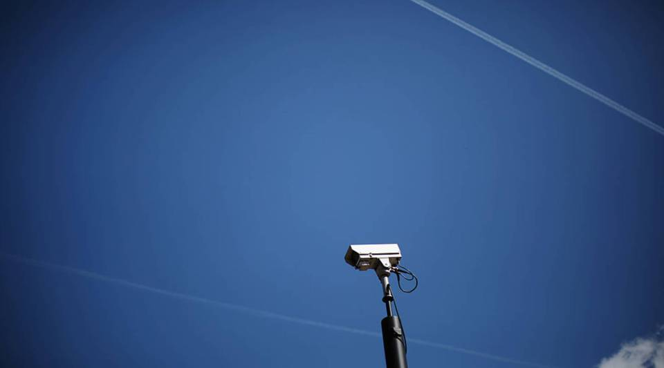 A surveillance camera overlooking a traffic stop in England.