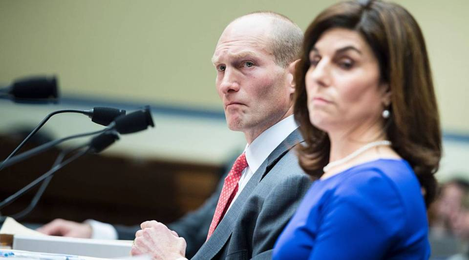 Howard Schiller, interim CEO of Valeant Pharmaceuticals International, and Nancy Retzlaff, chief commercial officer for Turing Pharmaceuticals, listen during a hearing of the House Oversight and Government Reform Committee on Capitol Hill February 4, 2016 in Washington, DC.