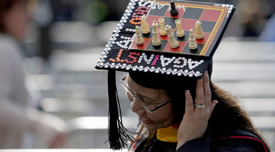 A student at Rutgers University shows her cap as she arrives to attend the 250th anniversary commencement ceremony on May 15, 2016 in New Brunswick, New Jersey.