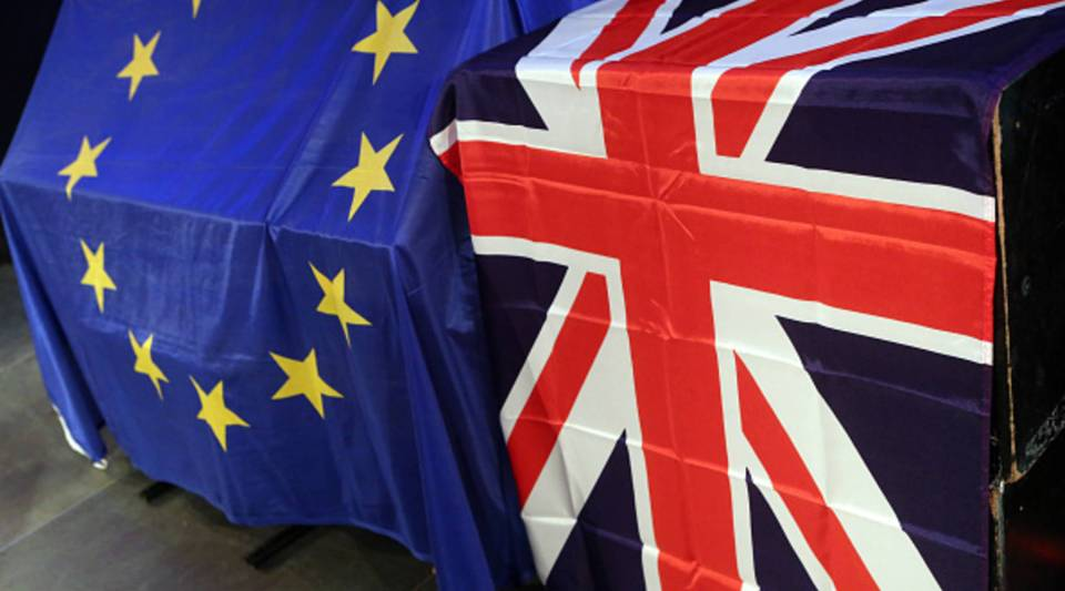 BERLIN, GERMANY - MAY 26: European Union (L) and British Union Jack flags hang at a meeting for British citizens living in Germany to discuss the implications of Great Britain leaving the European Union, known popularly as Brexit, on May 26, 2016 in Berlin, Germany. On June 23, 2016, UK citizens will vote on a post-legislative referendum on the country's membership in the European Union.