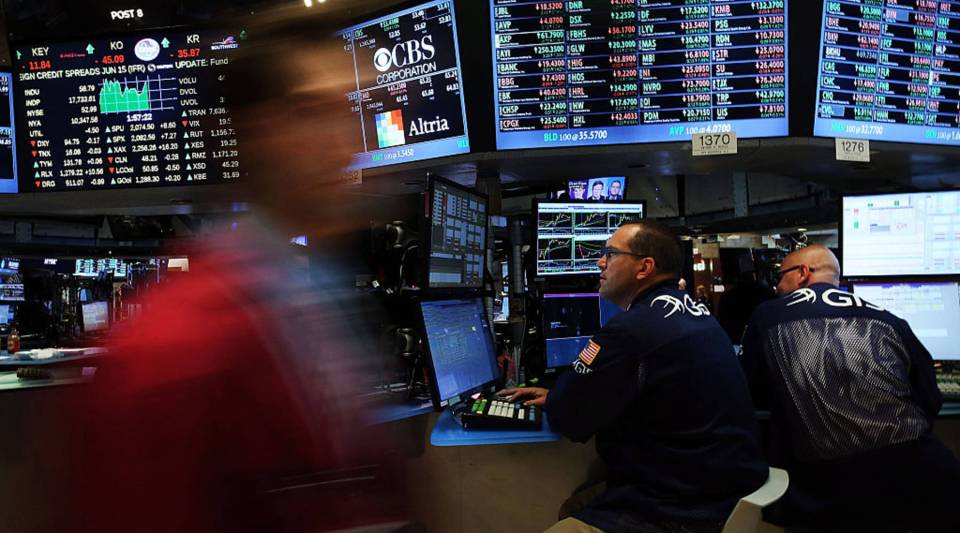 Traders work on the floor of the New York Stock Exchange. The IEX would be a new market to trade on with a 350 microsecond delay.