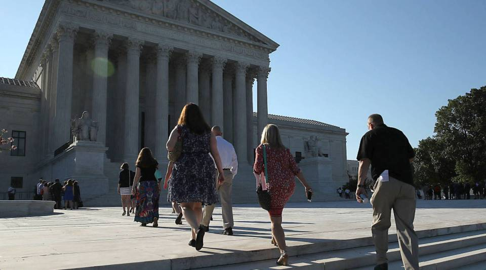 People walk up to the U.S. Supreme Court building June 20, 2016 in Washington, DC.