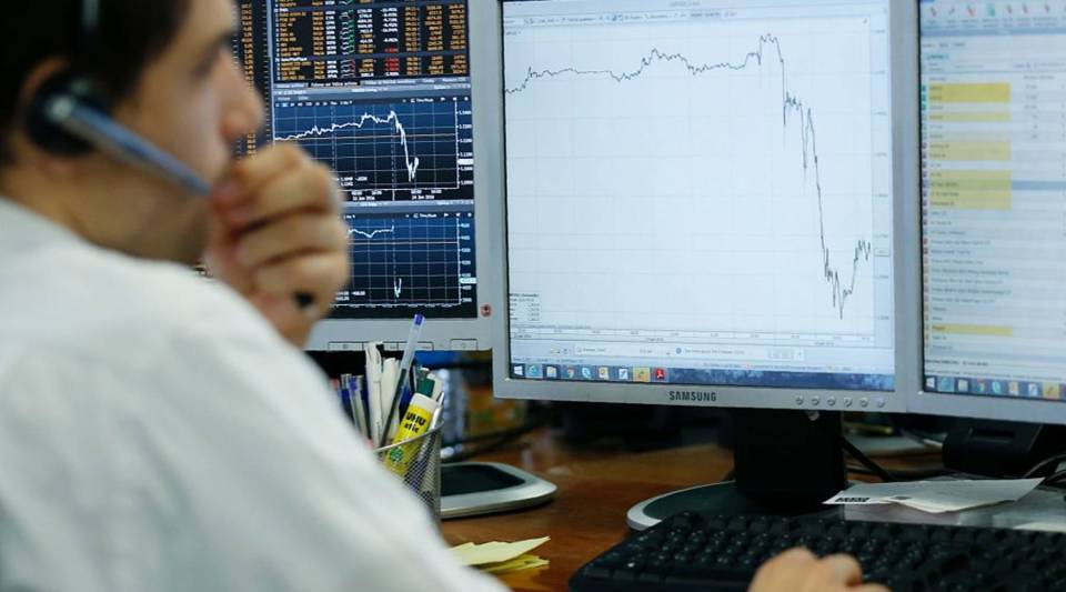 A trader watches his monitor on June 24, 2016, after the result of Britain's in-out referendum on EU membership, as Britain voted to leave the European Union.
