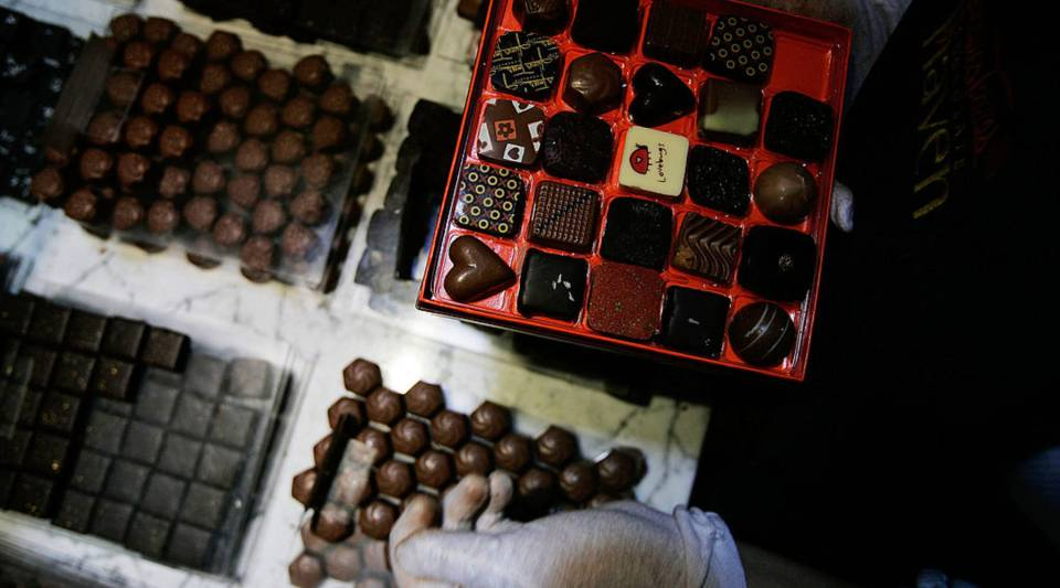 Chocolates are assembled into a gift box at a New York City shop in 2007. Demand for cocoa beans, a main chocolate ingredient, has been high for many years, but the supply continues to suffer.